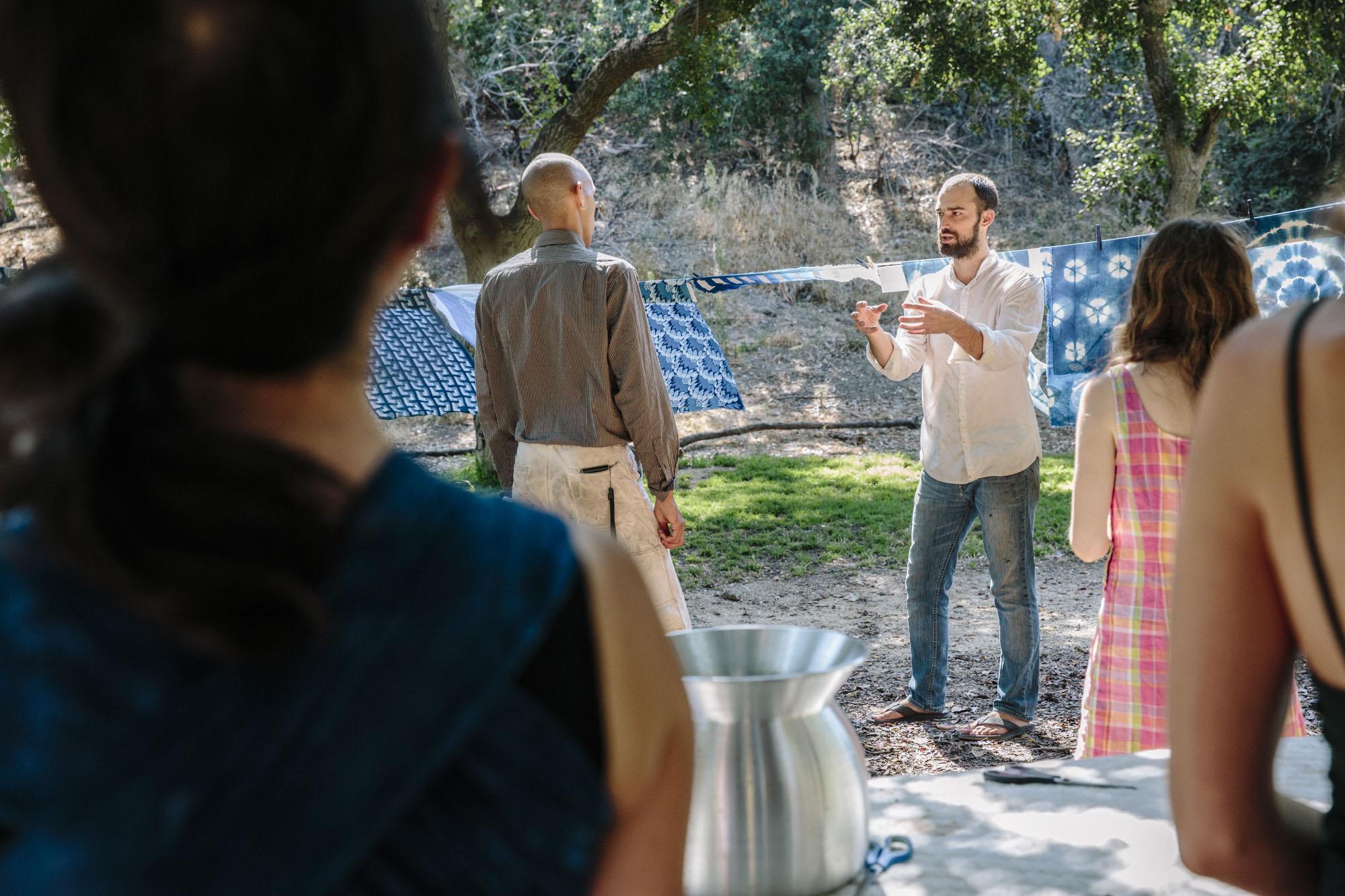 Graham Keegan Teaching Indigo Dye Workshop Outdoors.jpg