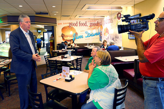 Mark Hurt talking to people and making a comercial while on the Senate trail in Tipton at Jim Dandy restaurant on Sept. 1, 2017.