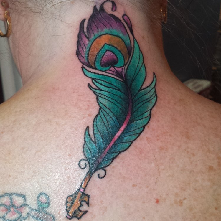 Peacock feather key in color. Back of the neck tattoo cover up.