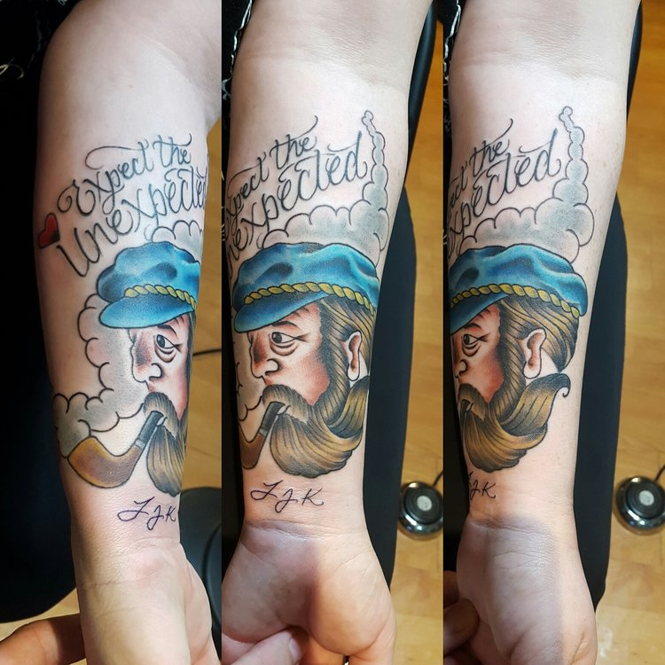 Sailor Captain with beard smoking a pipe in color. Forearm half sleeve tattoo.