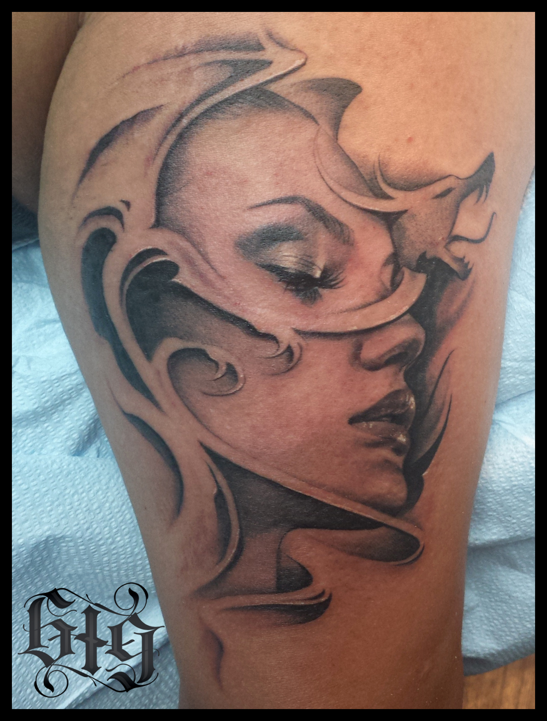 Fine detail black and gray side portrait pinup with tribal dragon. Upper arm half sleeve tattoo.