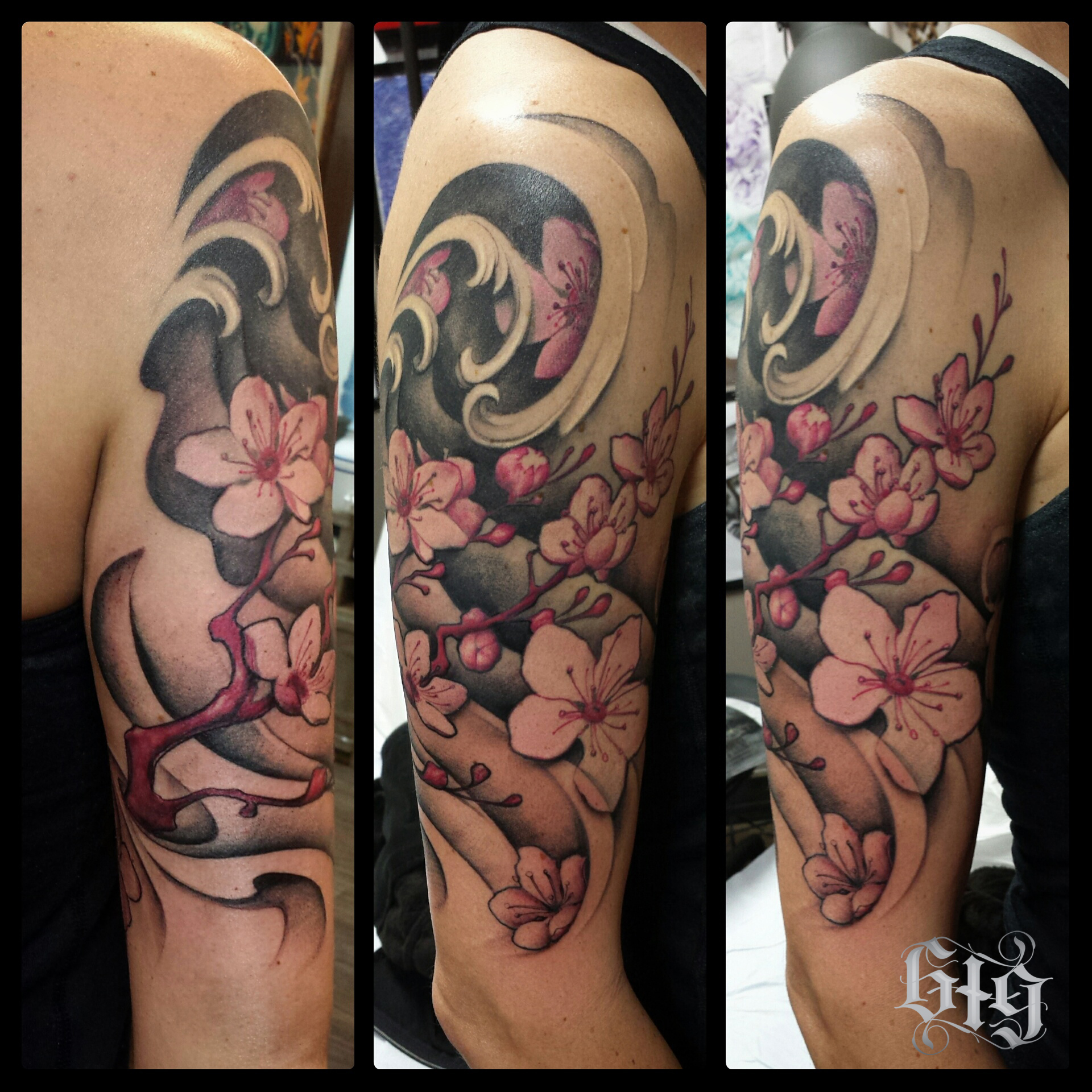 Japanese Cherry Blossoms. Black and gray with pink accents.  Upper arm half sleeve tattoo