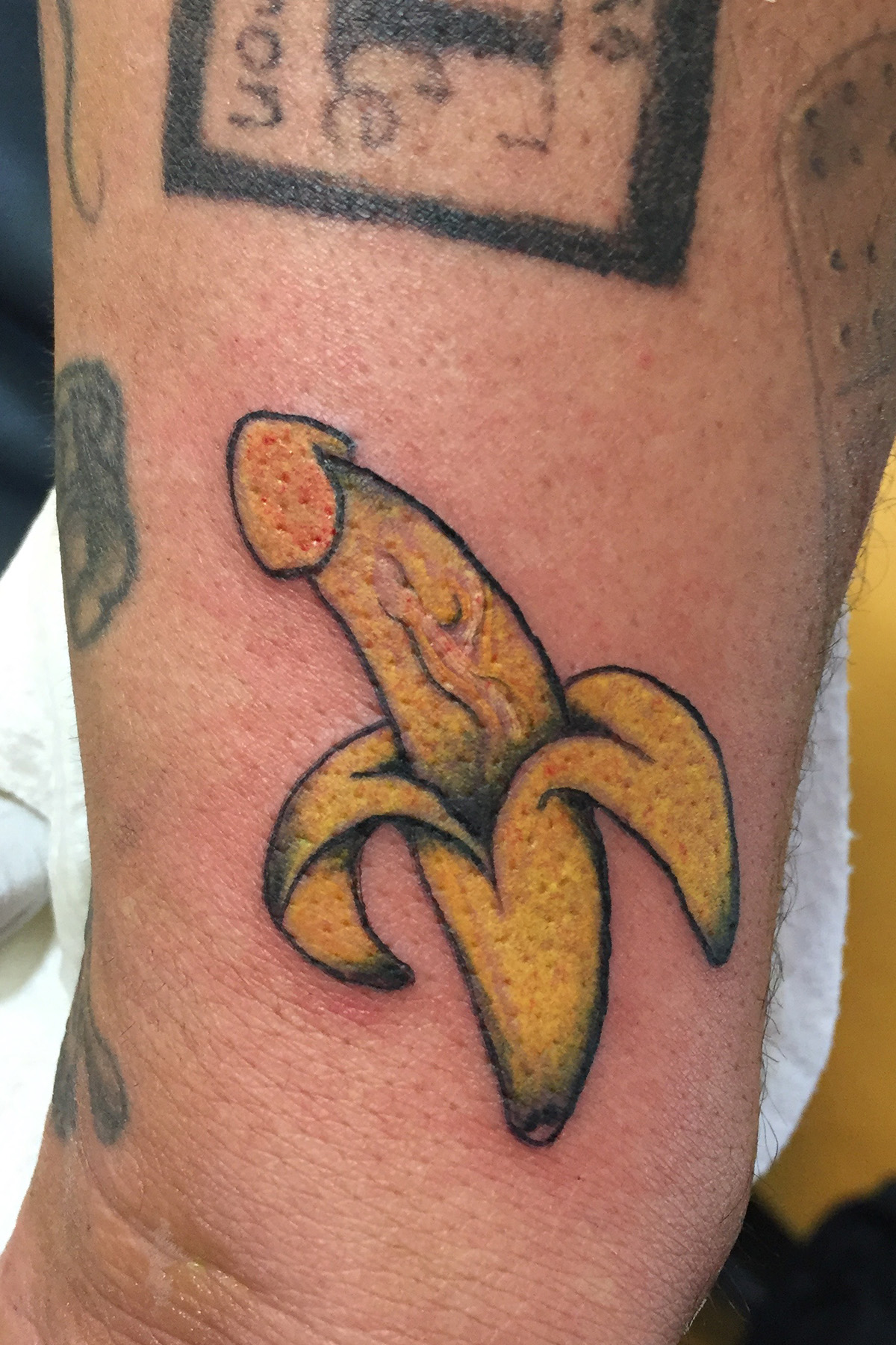 Yellow banana penis tattoo on the lower arm, half sleeve.Gold Stripe Tattoo located in the heart of North Park, San Diego, California. If you like what you see please click on the 'contact us' link below for your consultation.