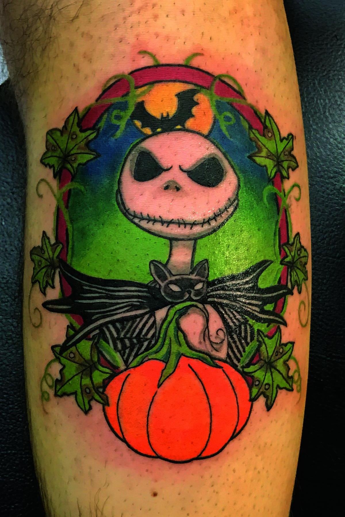 'Nightmare before Christmas' themed tattoo on calf in color. Jack the pumpkin king. Half leg sleeve.