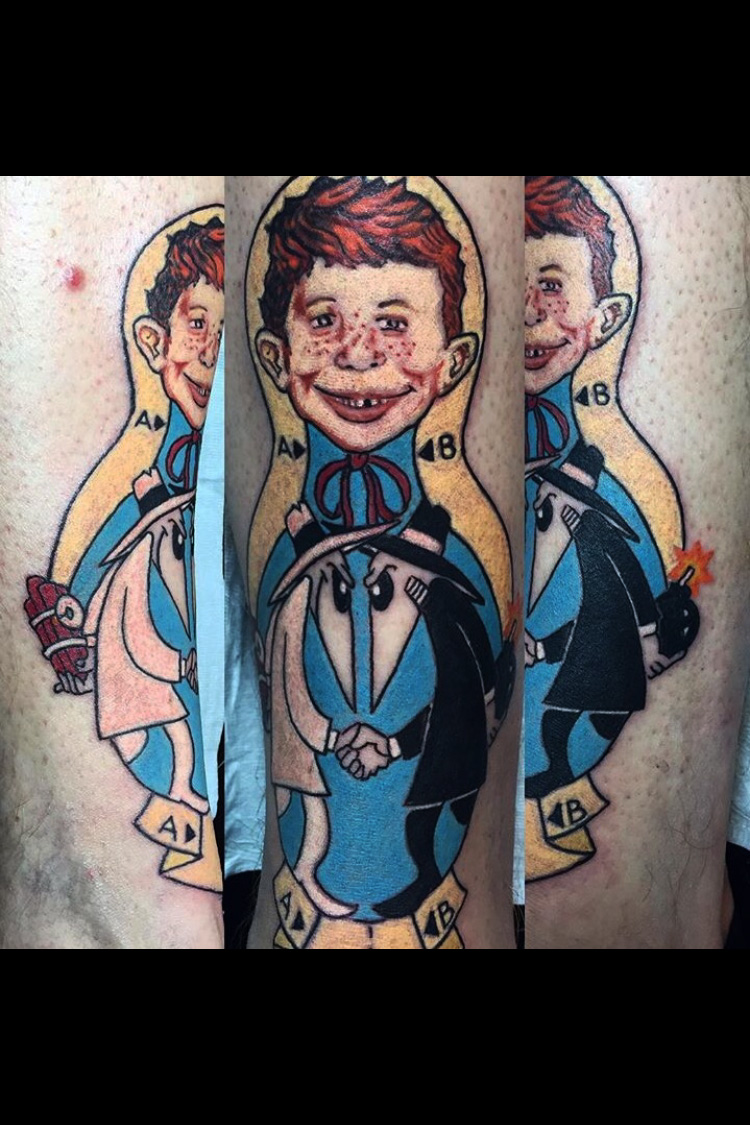 "Alfred E. Neuman, spy verses spy,  Mad Magazine, ""What me Worry"" designed into a Russian Nesting doll Color tattoo half leg sleeve."