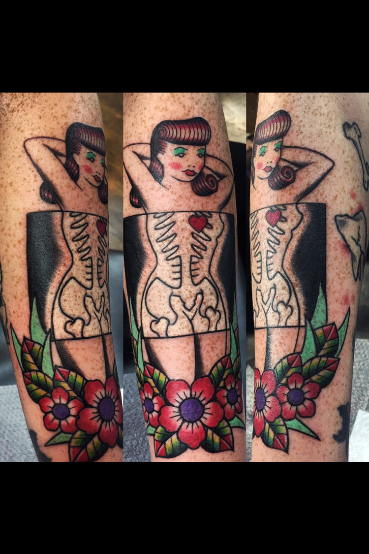 Traditional pinup getting an X-ray with flowers in color. Pinup Skeliton and bones.  Forearm half sleeve.