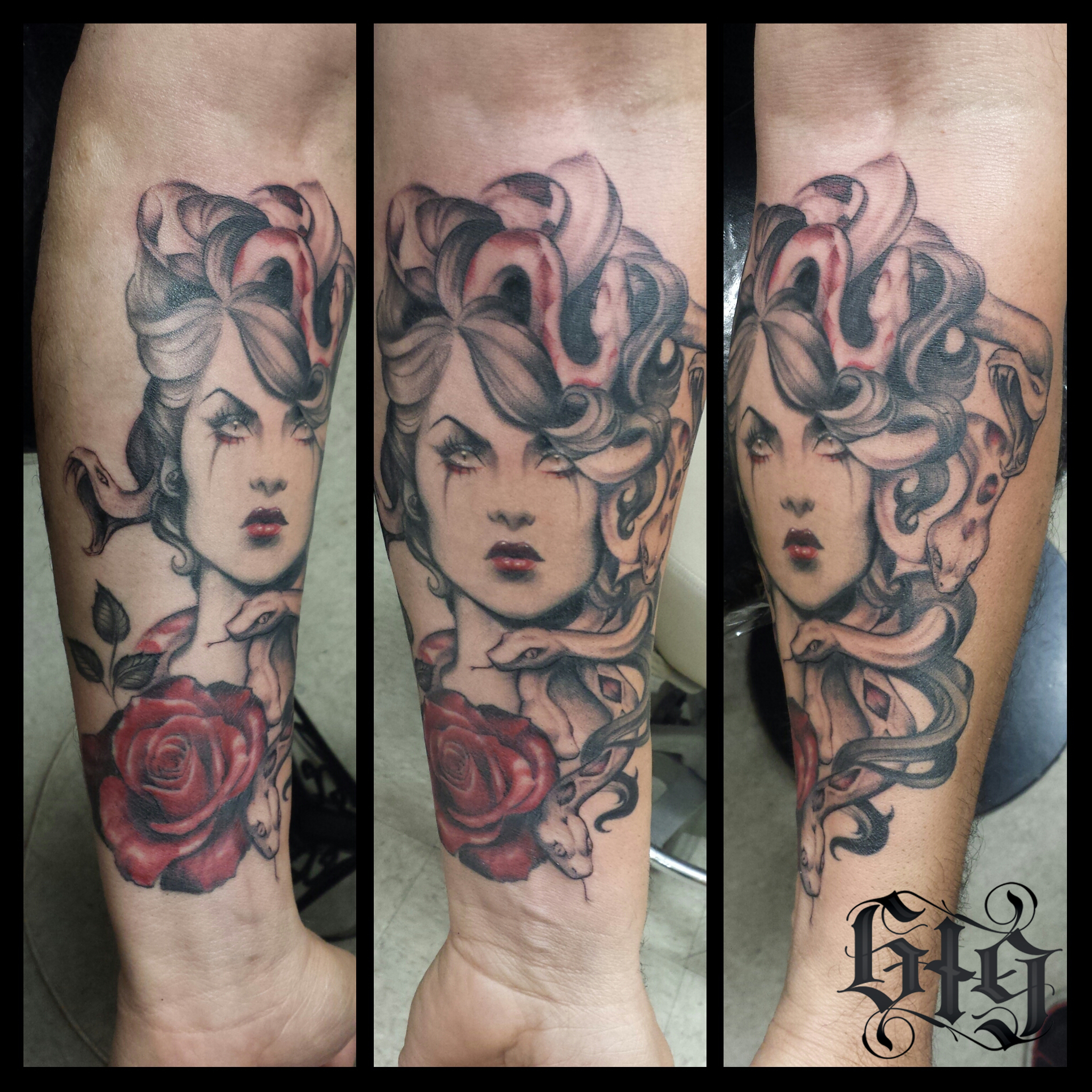 Female portrait with snakes in her curls and a red rose. Black gray and red forearm half sleeve tattoo.