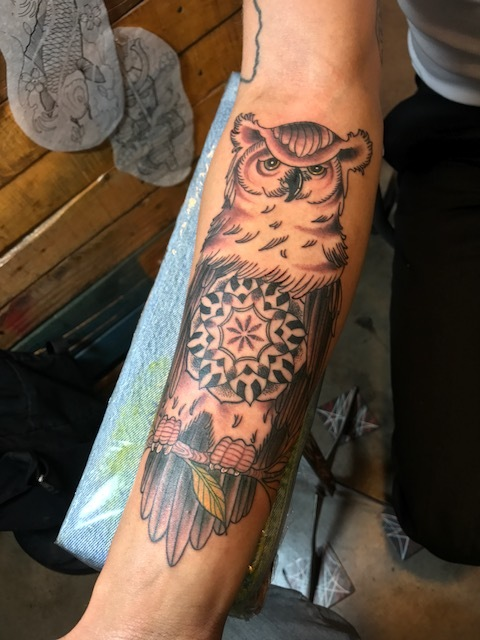 Black and gray detailed realistic owl. Forearm half sleeve Tattoo