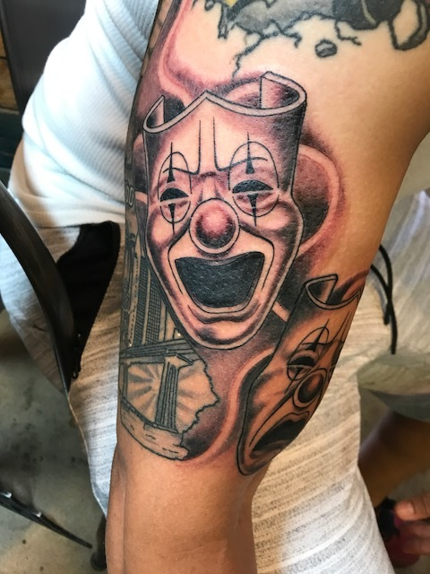 """Theater Masks """"Happy""""black and gray fine detail. Upper arm Half Sleeve Tattoo."""