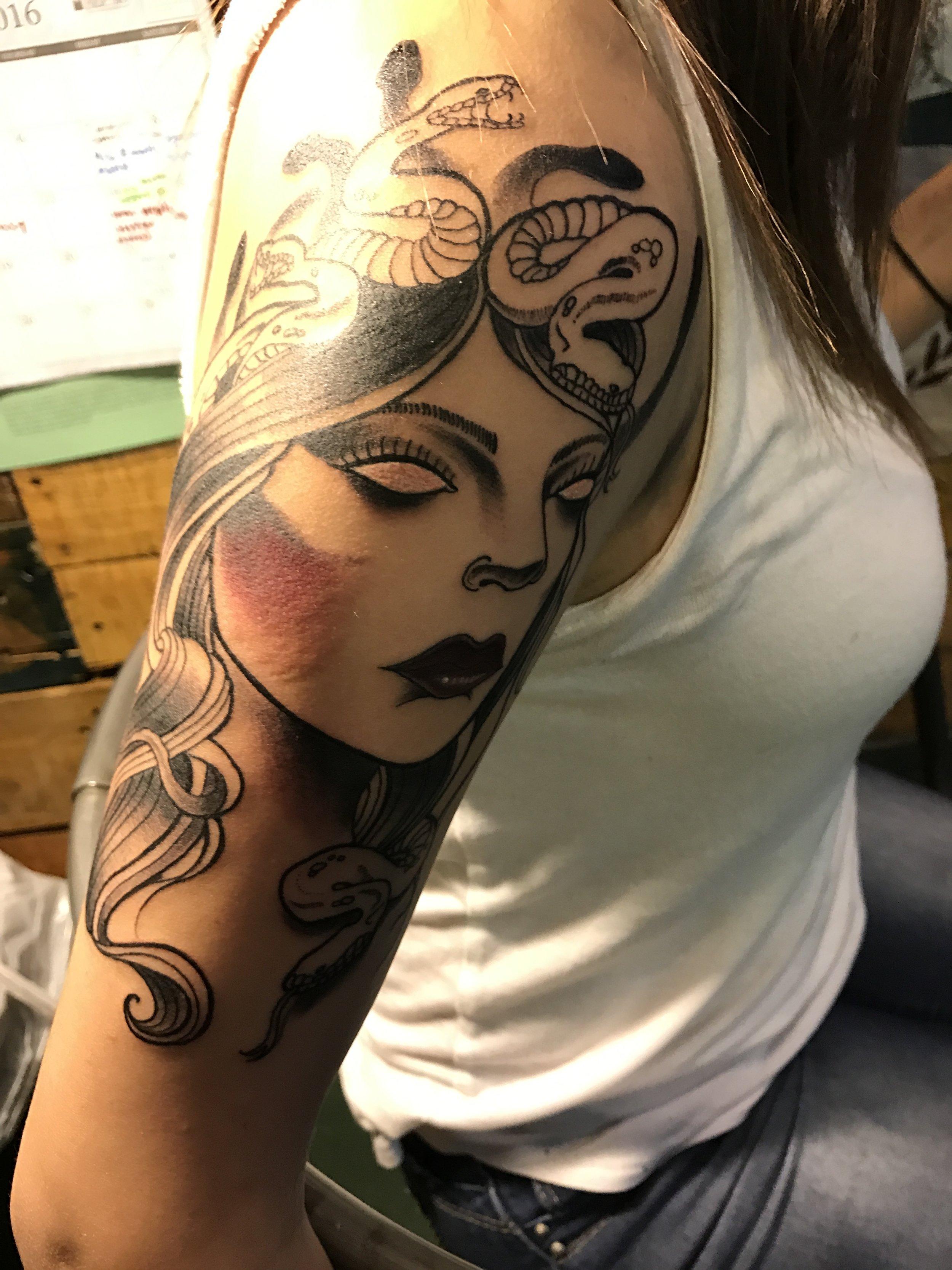 Fine detailed black and gray Medusa portrait upper arm half sleeve tattoo.