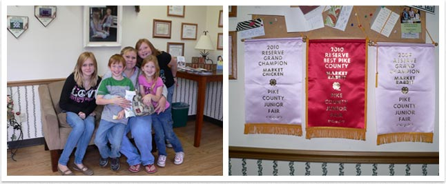 (Left) Proud 4-H kids on couch in our office. (Right) Banners for junior fair winners hung in our practice on right.