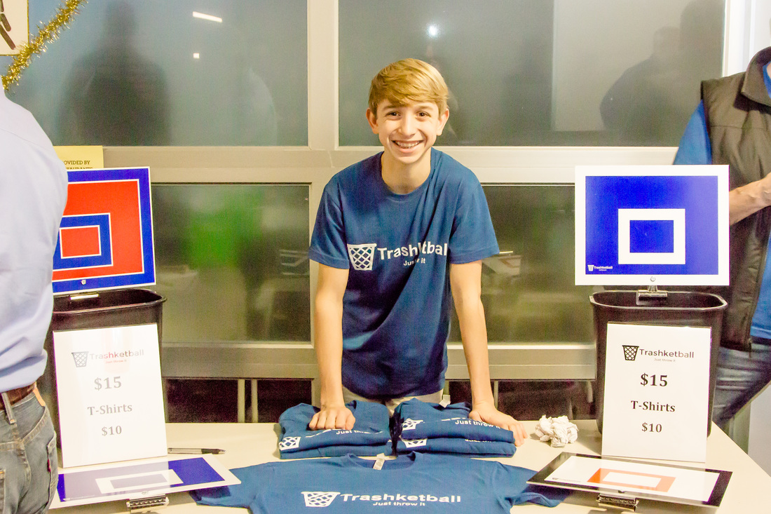 TRASHKETBALL    The idea for a trashcan backboard came to CJ as part of a 2015 Break Into Business camp. He transformed his original product, made of recycled boxes, into a professional design in various team colors. They've been a hit in corporate offices.