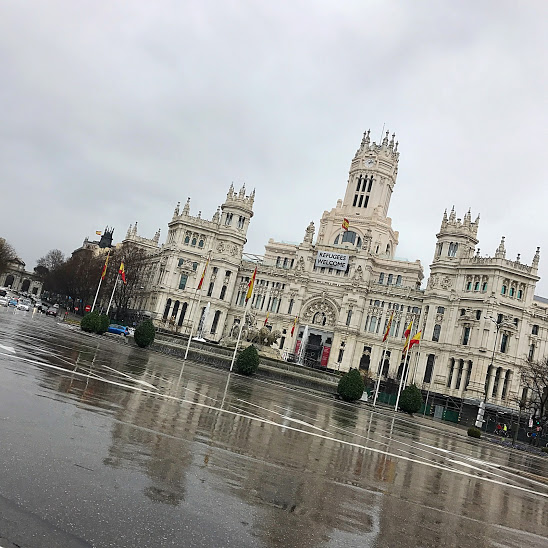 """Plaza de Cibeles (City Hall) in Madrid with a """"Refugees Welcome"""" banner. As we discuss tourism, diversity and inclusivity is so important. Thousands across Spain have recently protested to welcome all."""