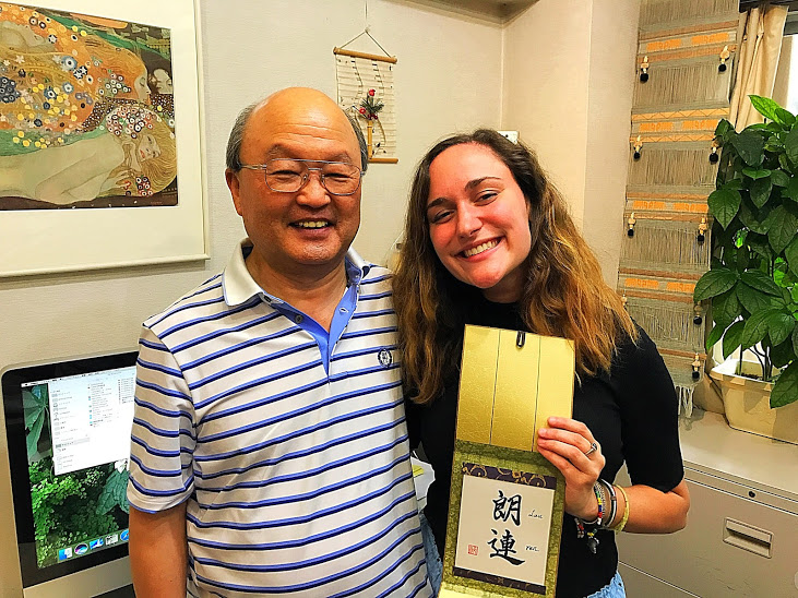 """Tenshin, my calligraphy instructor, and I! He made us each our names in these letters. Lau means """"pleasant"""" and ren means """"continuously"""" so Lauren= continuously pleasant :) So kind and generous of him!!"""