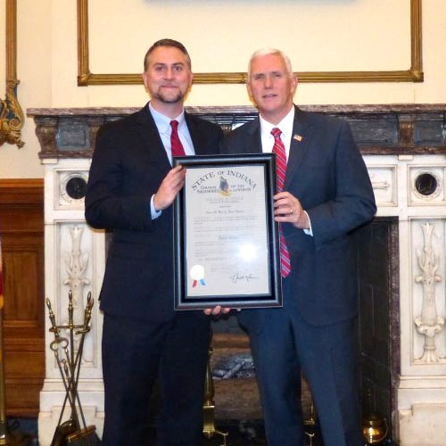 Brian Bailey receiving the Sagamore Award from Governor Mike Pence