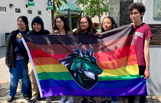 Participants in a youth leadership team show off the Pride flag they were able to fly at Sonoma Valley High School that includes the campus' dragon mascot. Holding up the flag, from left to right, are Maria Ramirez, Axel Sagrero, Itzel Montes, Maggie Castro, Michel Bernal, and José Valdivia.