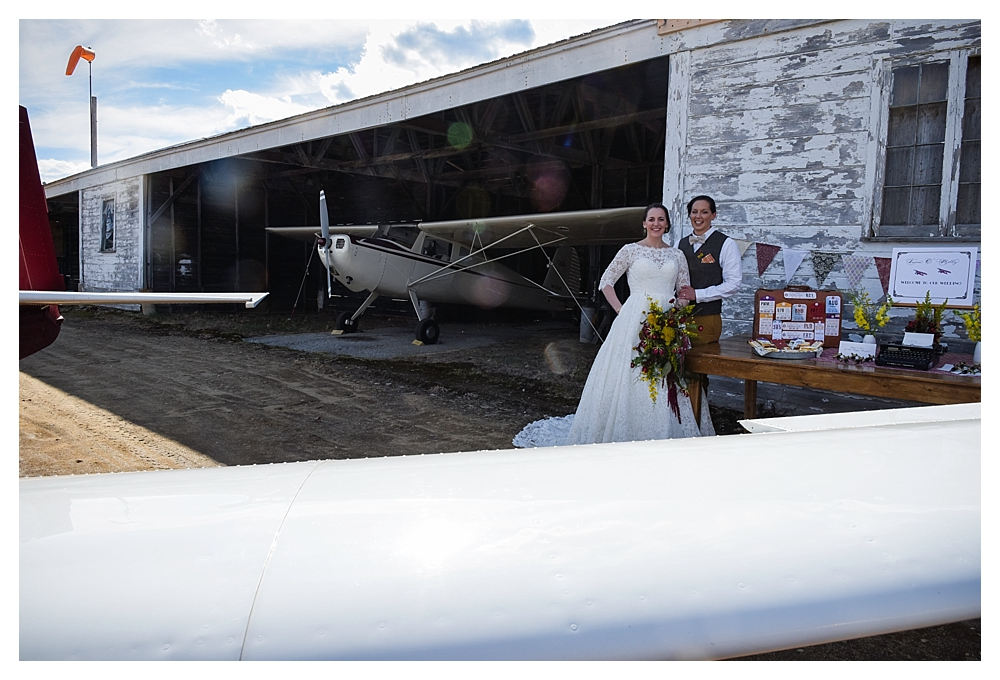 Amelia Earhart Vintage Hangar Wedding Welcome Table Two Brides.jpg