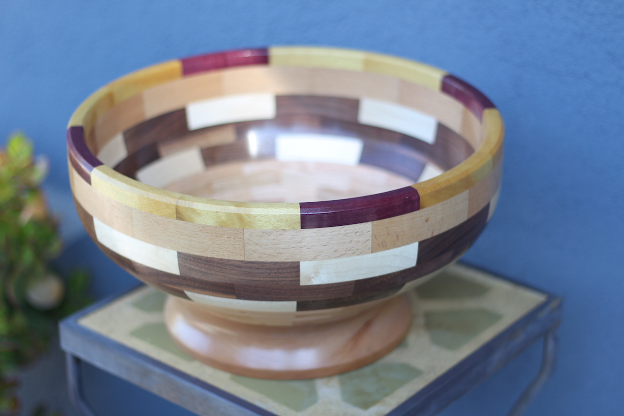 Segmented turned bowl made of Beechwood for the base, Walnut, Maple, Oak, and Purple and Yellow Heart for the top ring.