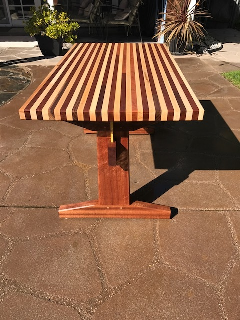 Outdoor table on African Mahogany for the base, and combination of Maple and Mahogany for the top.