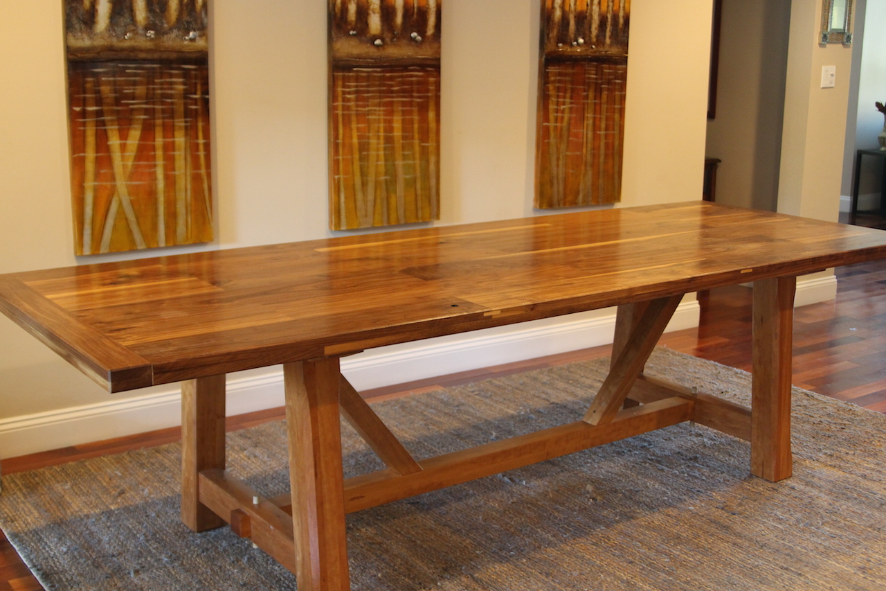 Dining table made of Walnut for the top and Cherry for the base.   9ft. x 4ft.    This is a knock down design, the table comes apart in 6 pieces for easy transport.