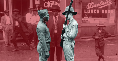 Armed National Guards and African American men standing on a sidewalk during the race riots in Chicago, Illinois, 1919.   Jun Fujita/Courtesy of the Chicago History Museum