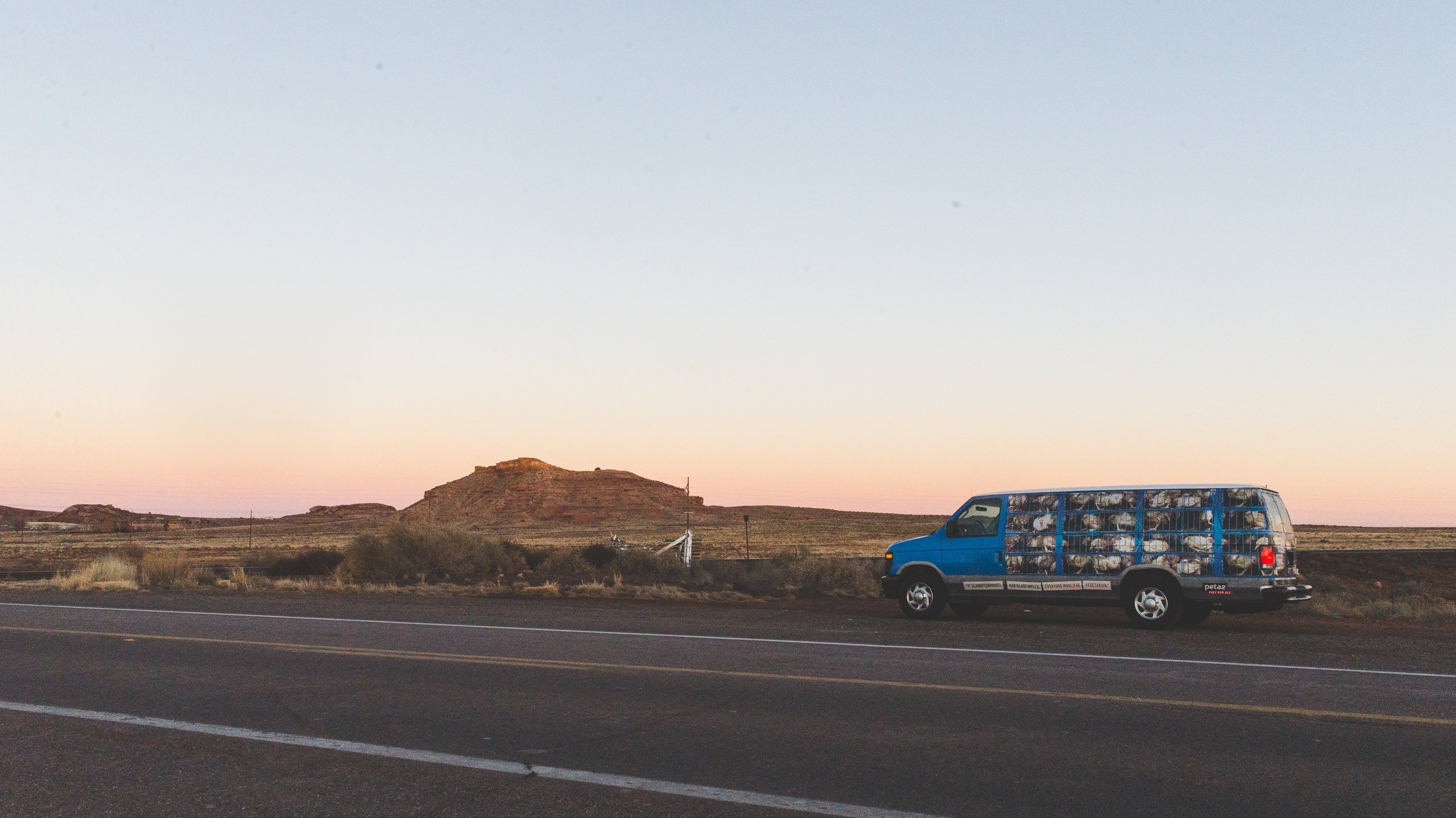 Our van in front of a sky that looks like watercolors. / 2/9/16 / Holbrook, AZ