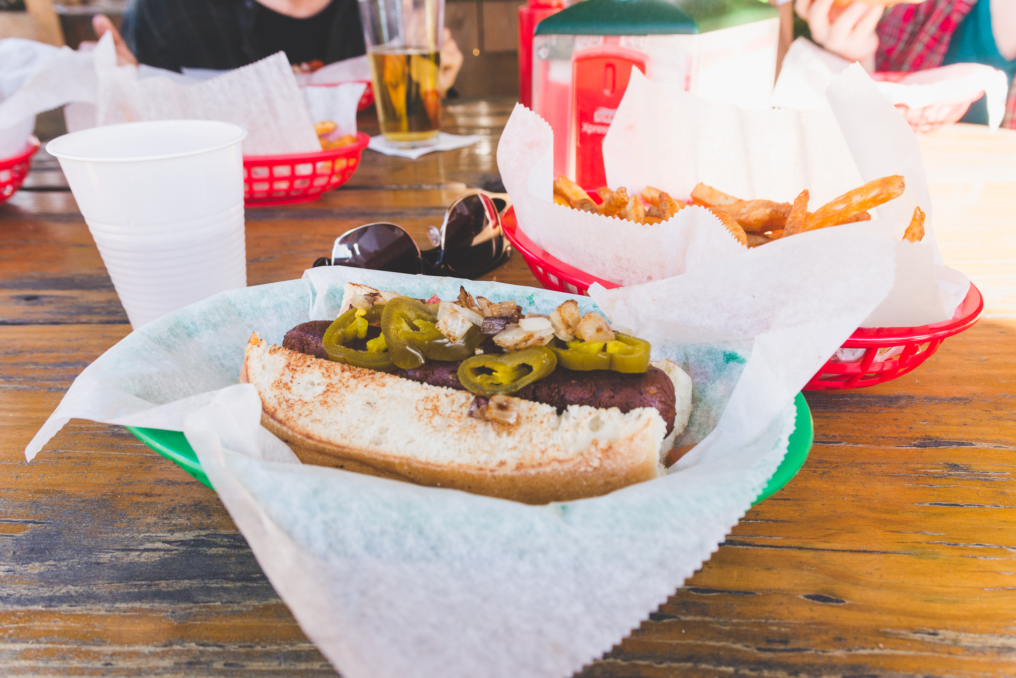 "Spicy chipotle ""sausage"" with hummus, jalapenos, pickles, and tomatoes, soon to be covered in ketchup. / 2/25/16 / Dat Dog / New Orleans, LA"