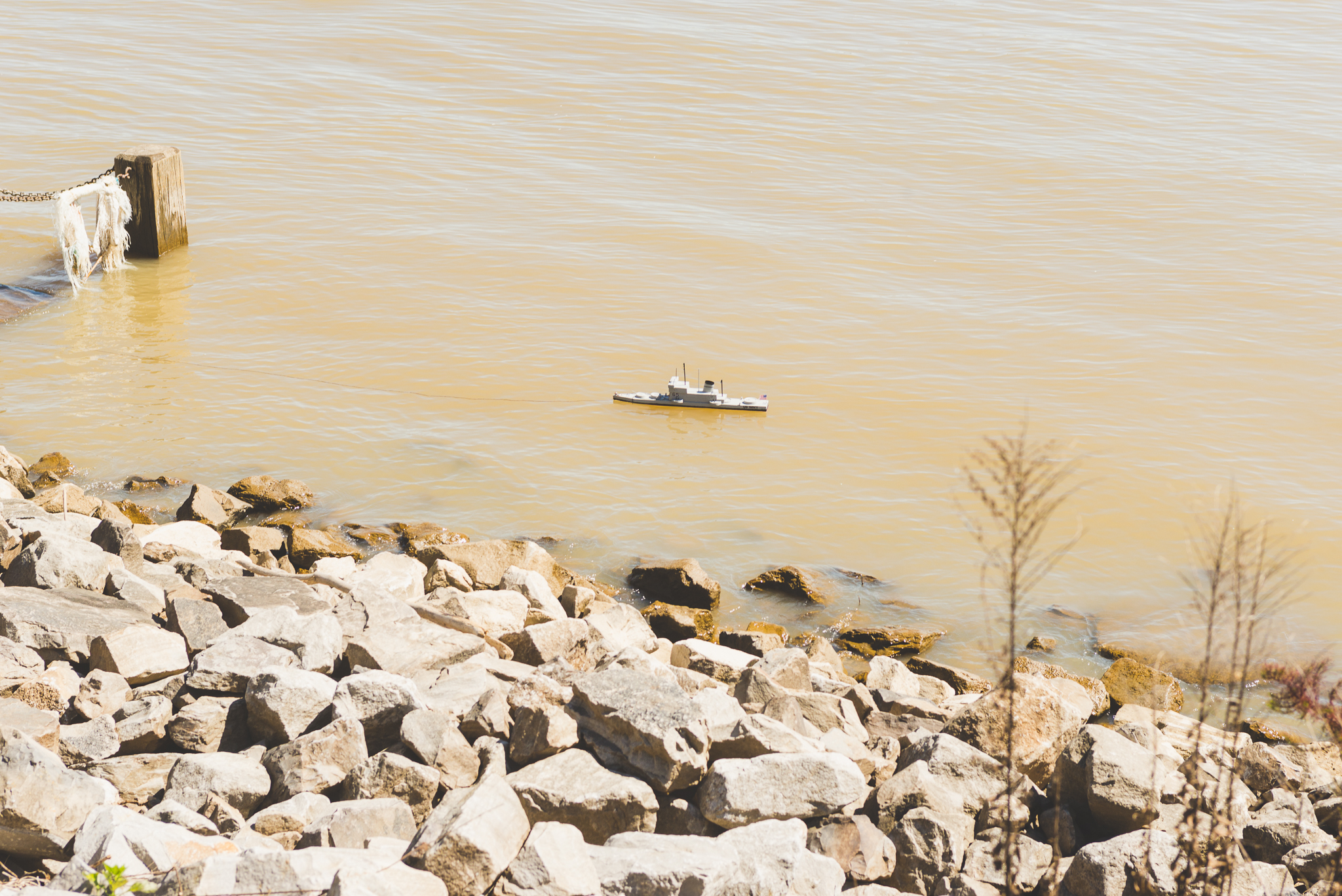 Toy boat in the Mississippi River. / 2/27/16 / New Orleans, LA