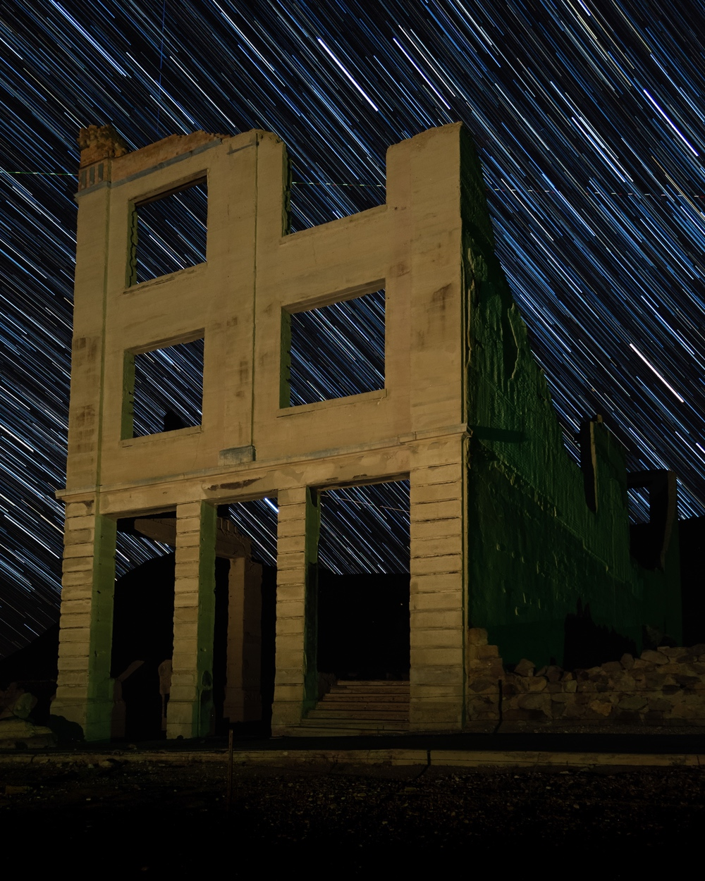 Star trails behind the old Cook Bank in the ghost town of Rhyolite, Nevada.
