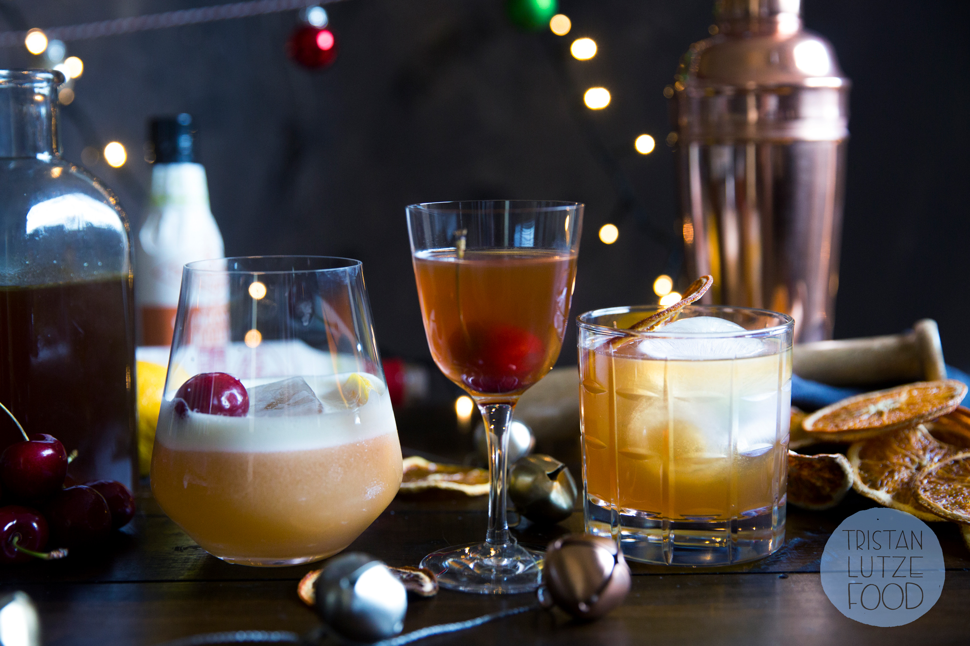 Christmas whiskey sour, Manhattan and Old Fashioned, all made with Christmas pudding-infused whiskey.