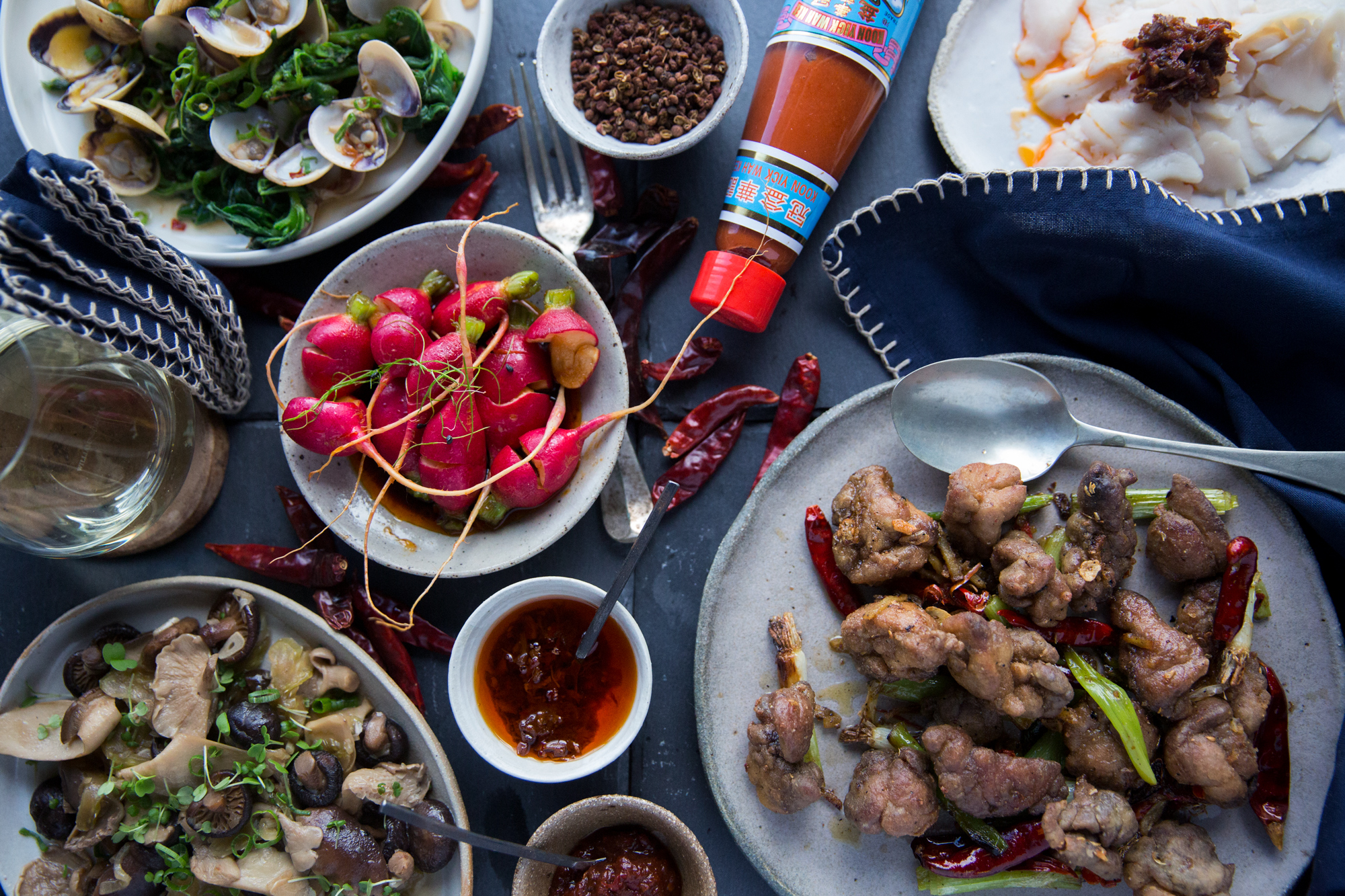 Salt and pepper sweetbreads, radishes with chilli oil, stir fried mushrooms with cuttlefish, clams with samphire and XO.