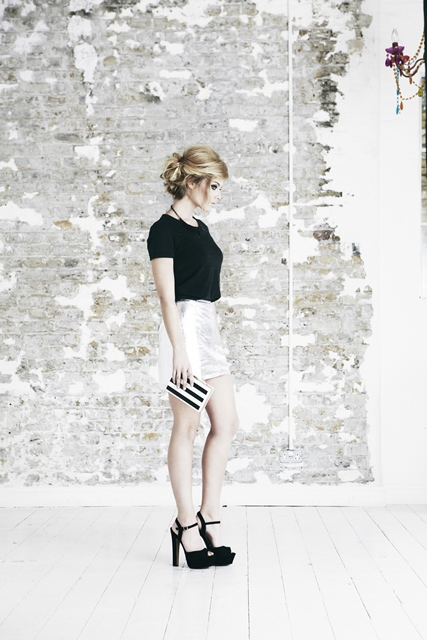 Chic Chignon    Short and longer styles are swept up into a chic chignon to delicately frame the face.