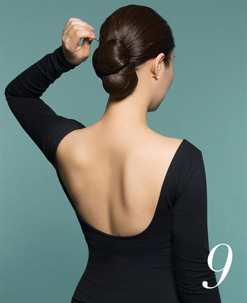 Use bobby pins to secure your low bun and set in place with a spray of Finishing Spray.