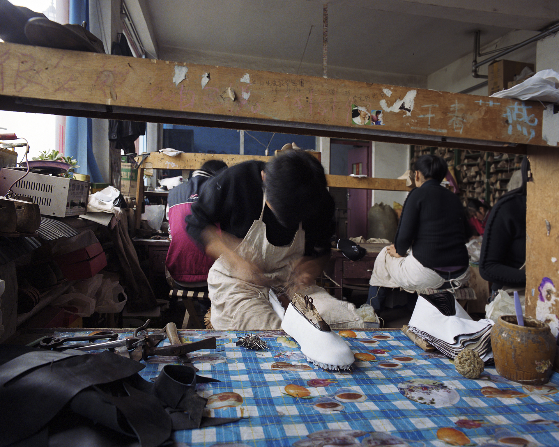 Young workers in the small shoe factory.