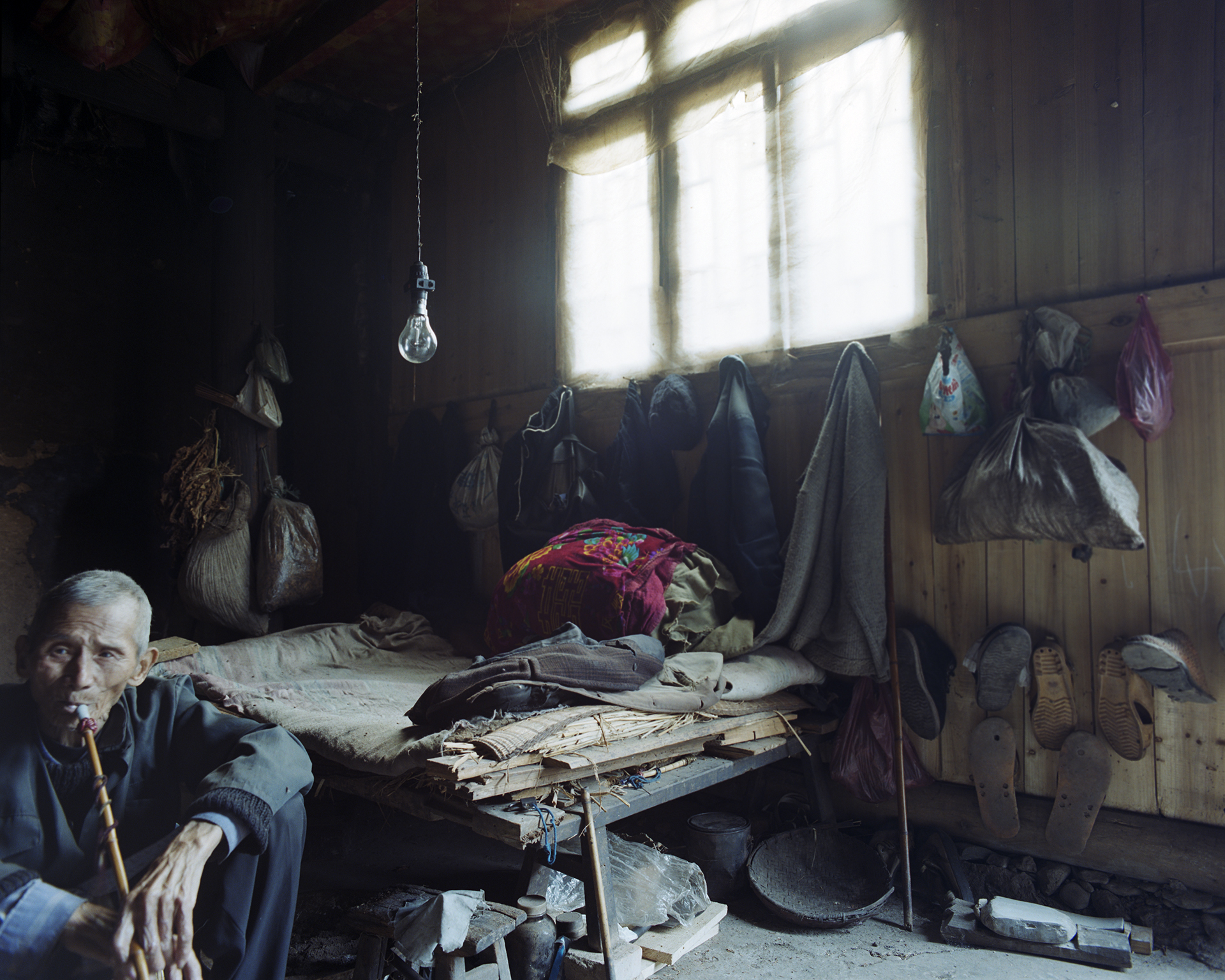 Not everybody in Zhaoxing could reap the money from tourism. In 2005 many older people still live like this.