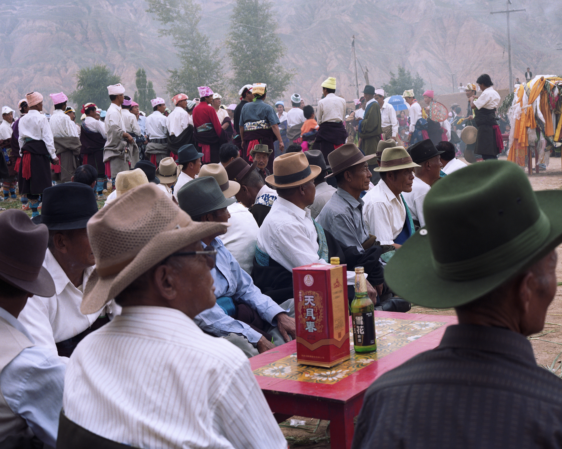 2007 Qinghai -it is festival time and in many villages people are gathering on the grounds of the monastery for the traditional festivities.