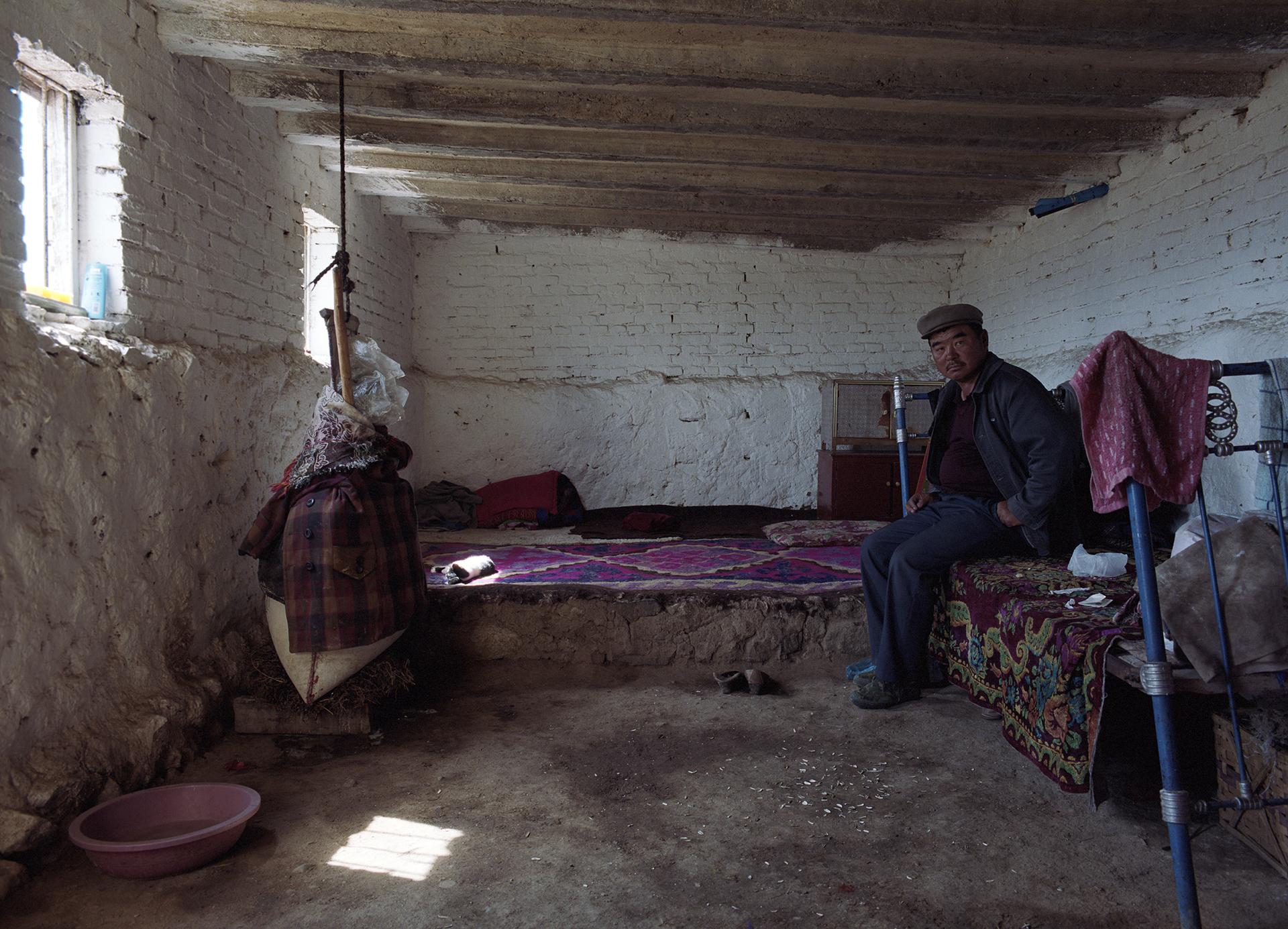 2007 Xinjiang - a Mongolian cheese maker in his summer home.