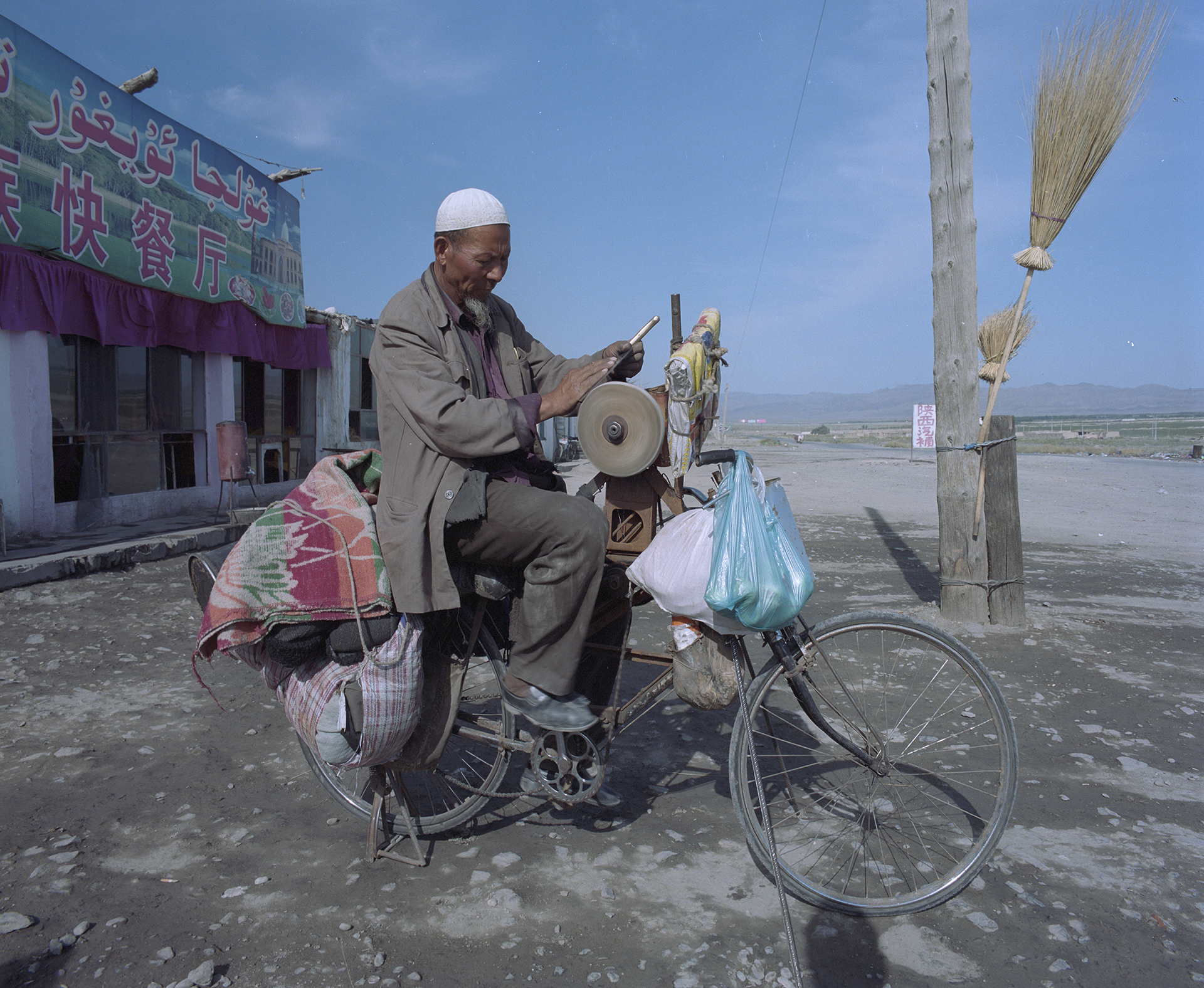 2007 Xinjiang - mobile knife-grinder along the road.