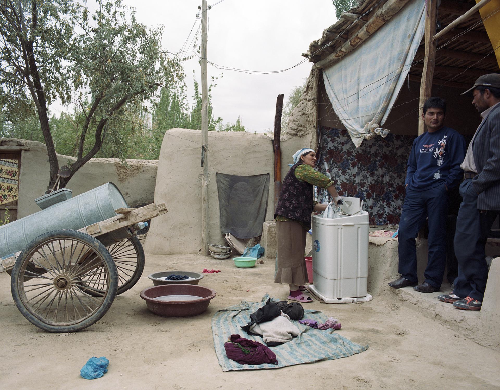 2007 Xinjiang - doing the family laundry in Kokyar.