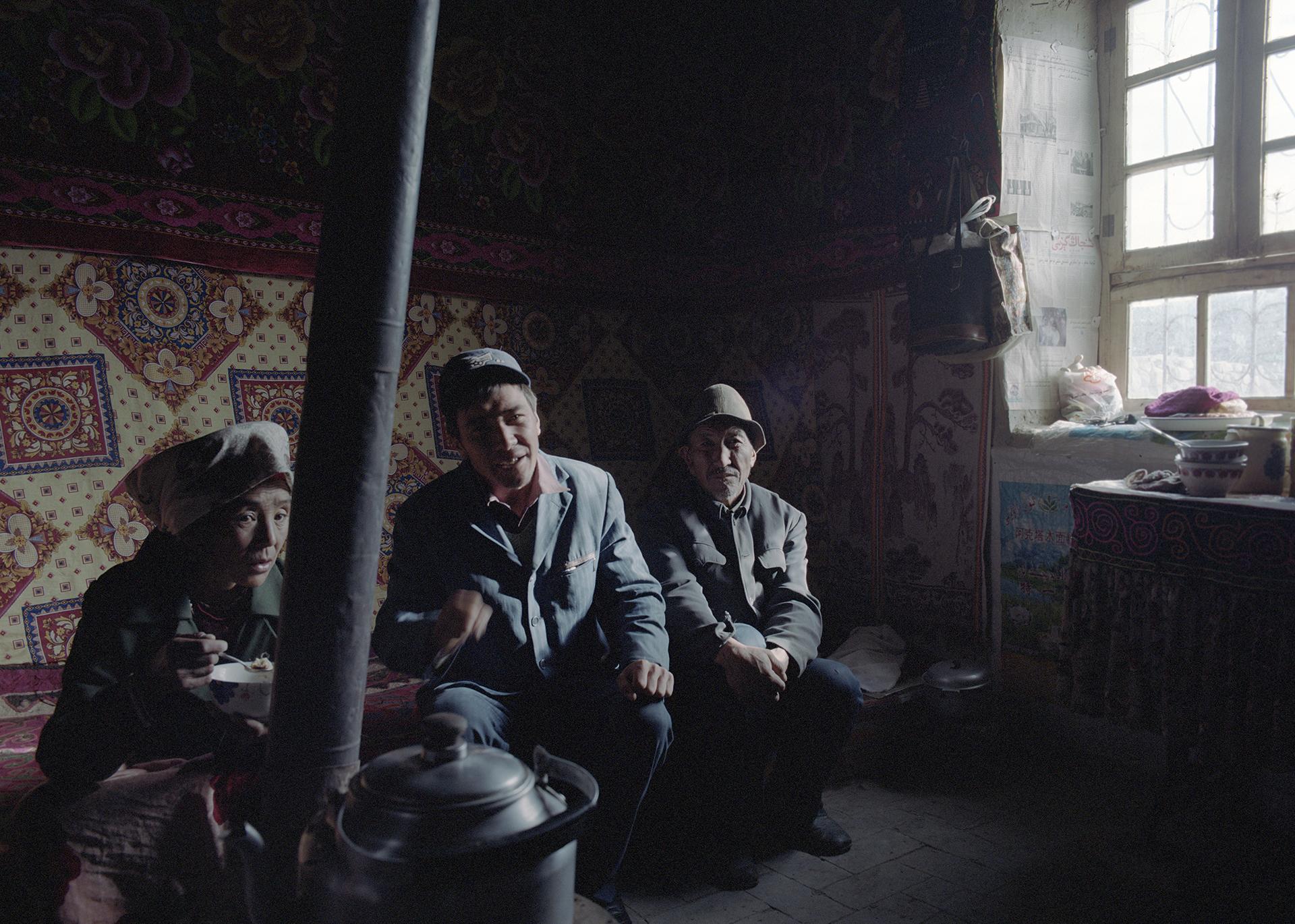 2007 Xinjiang -village family at breakfast.