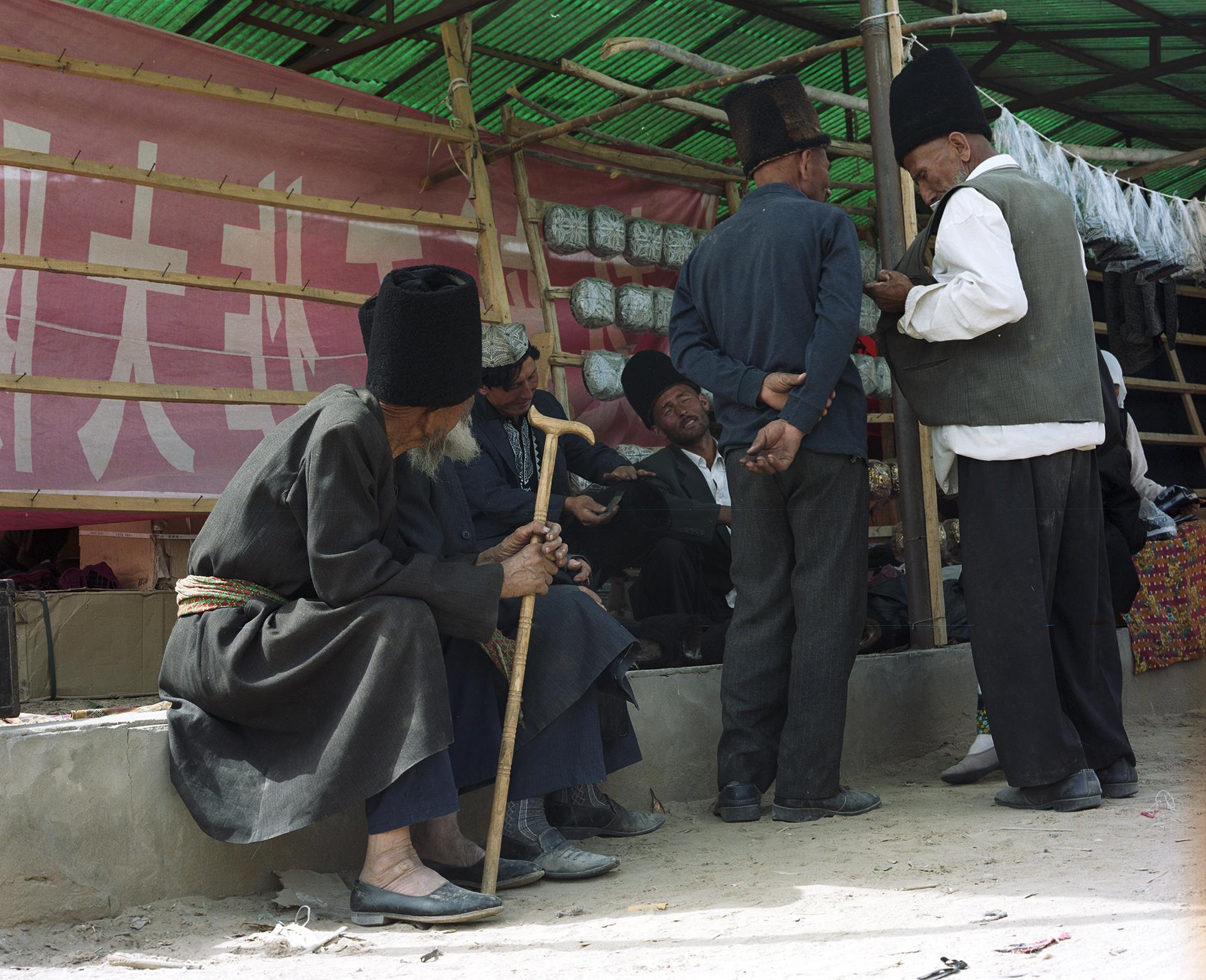 2007 Xinjiang - mens'corner at a local market on the Silk Road.