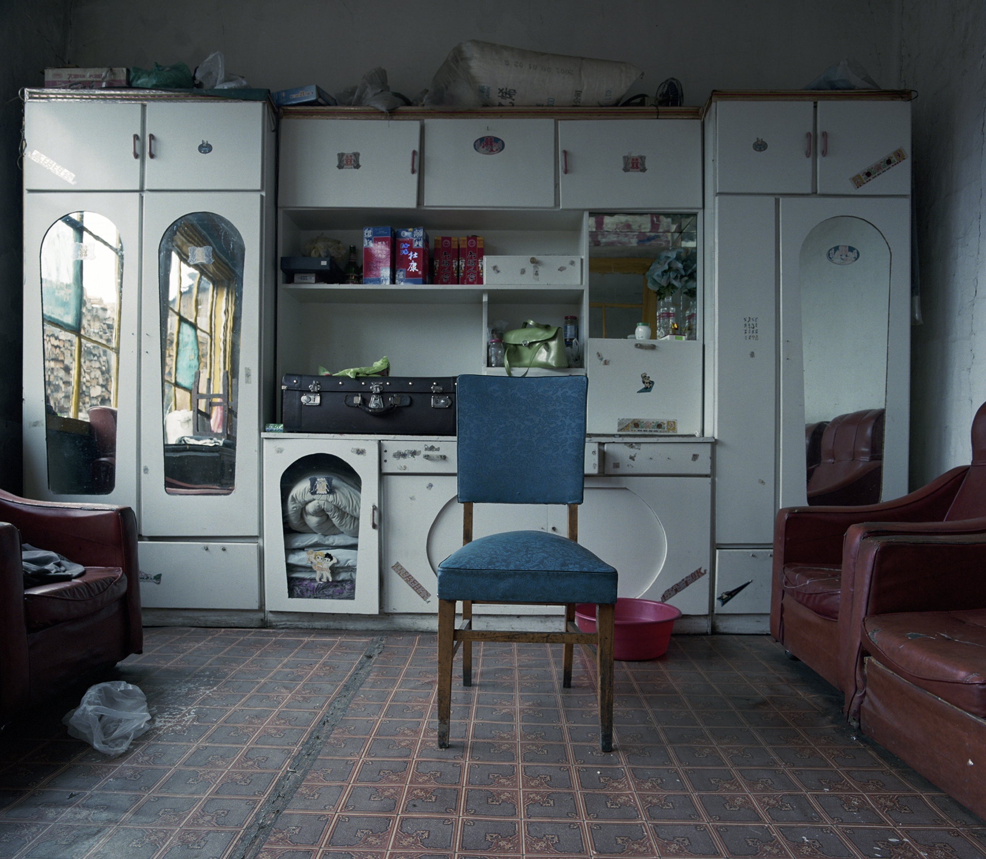 2008 Heilongjiang - This interior is more Russian than Chinese with this beautiful blue chair and the big leather sofa's.