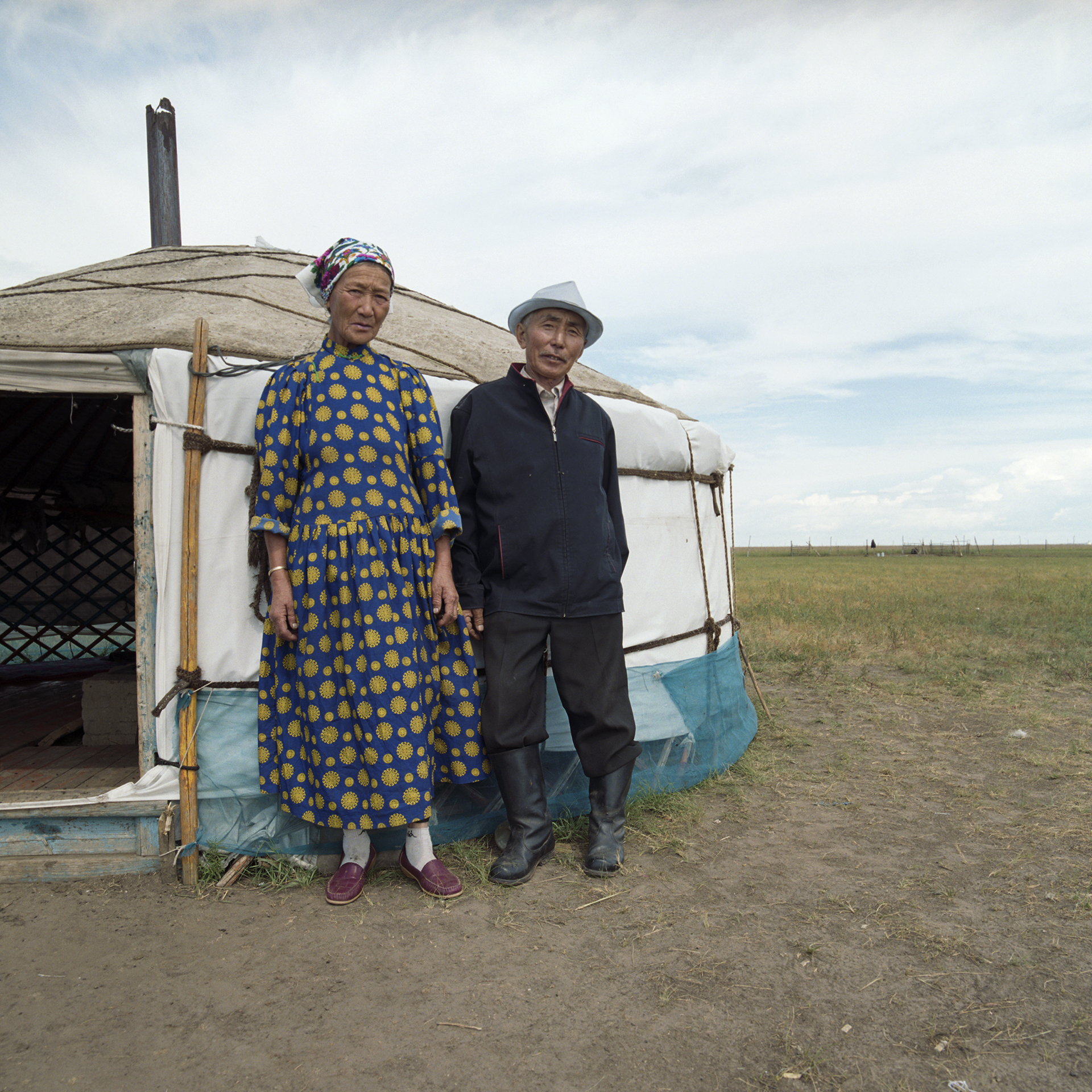 2008 Inner Mongolia - an old couple in front of their yurt.