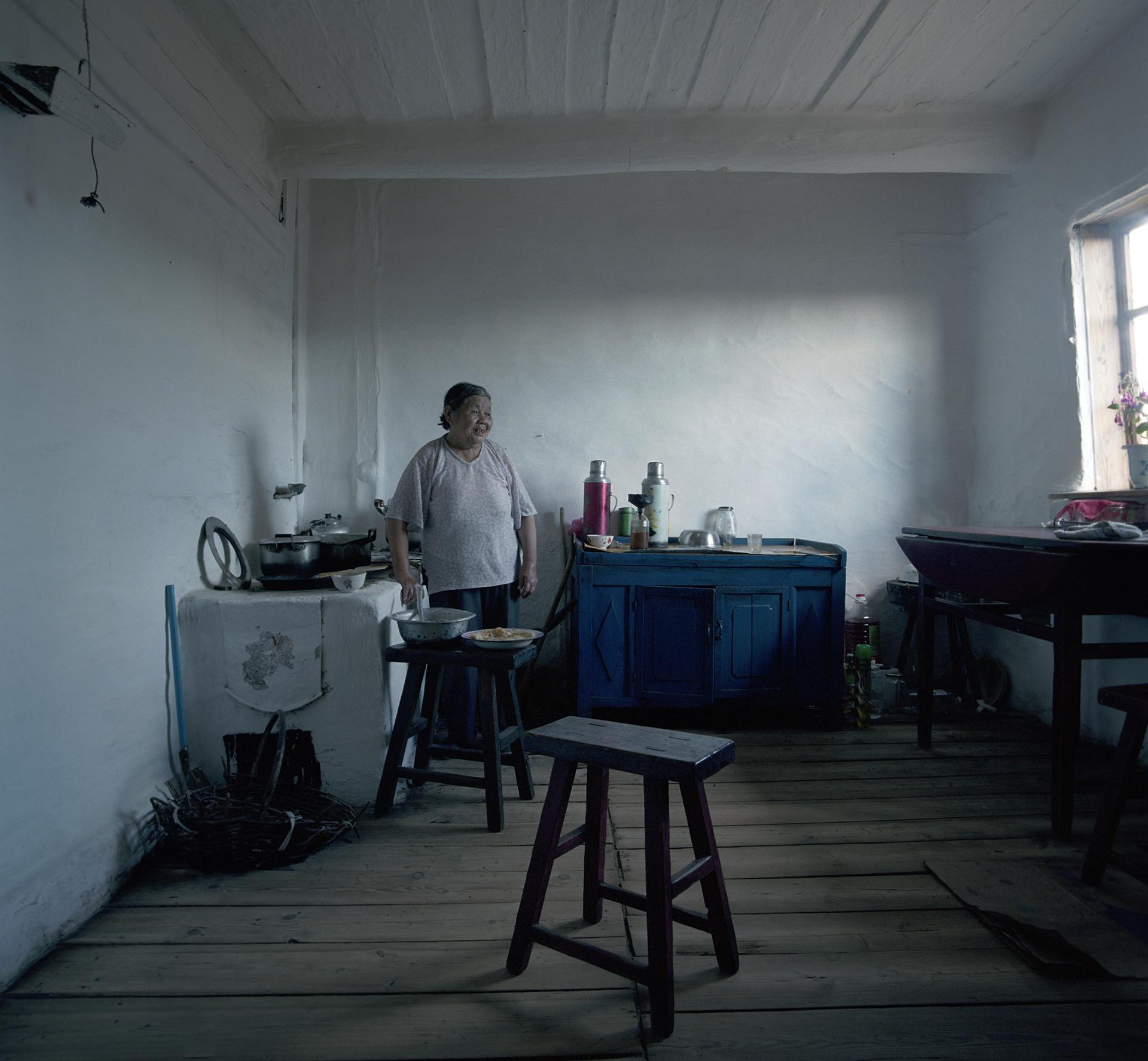 2008 Inner Mongolia - babouschka is baking real Russian blini's.
