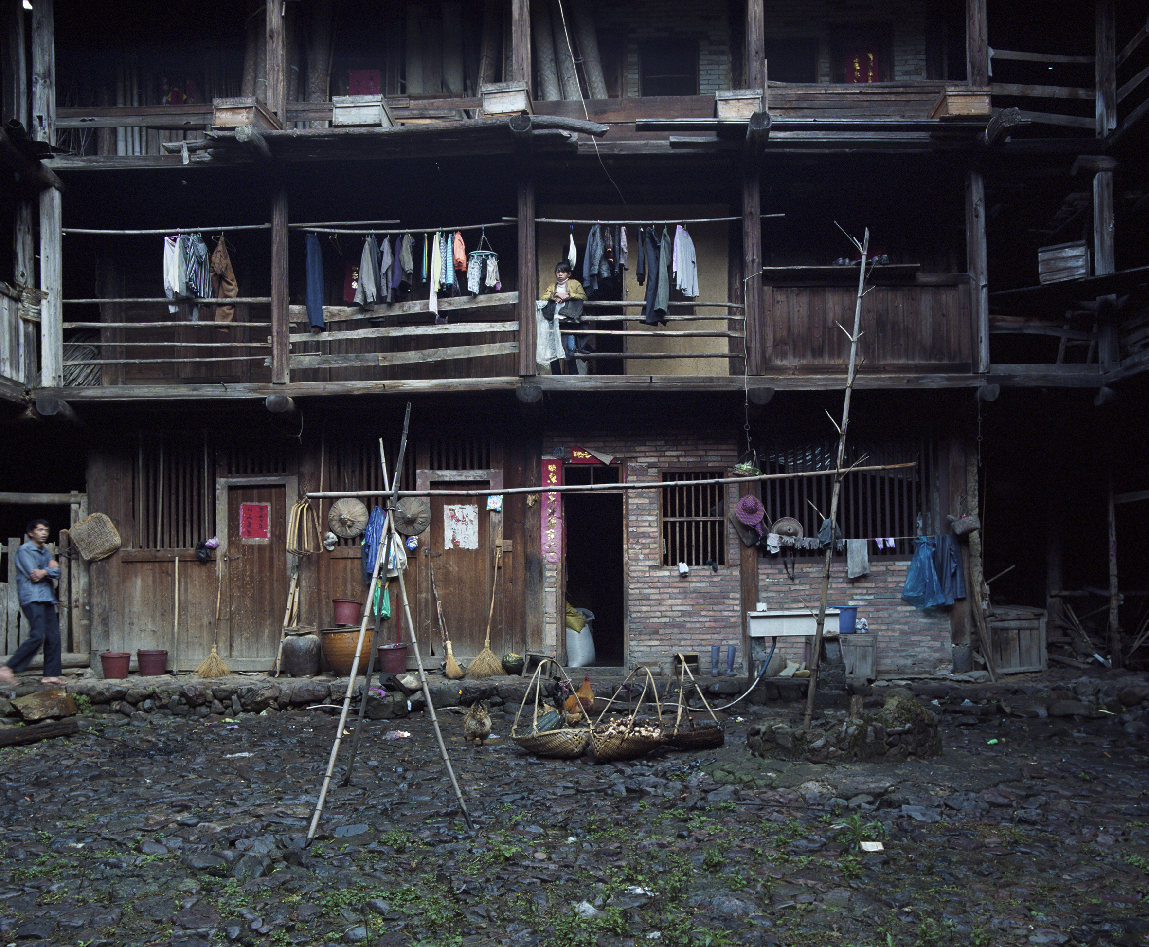 2009 Fujian - front of a Hakka house. On court level the living spaces, sleeping spaces higher up, storage above.