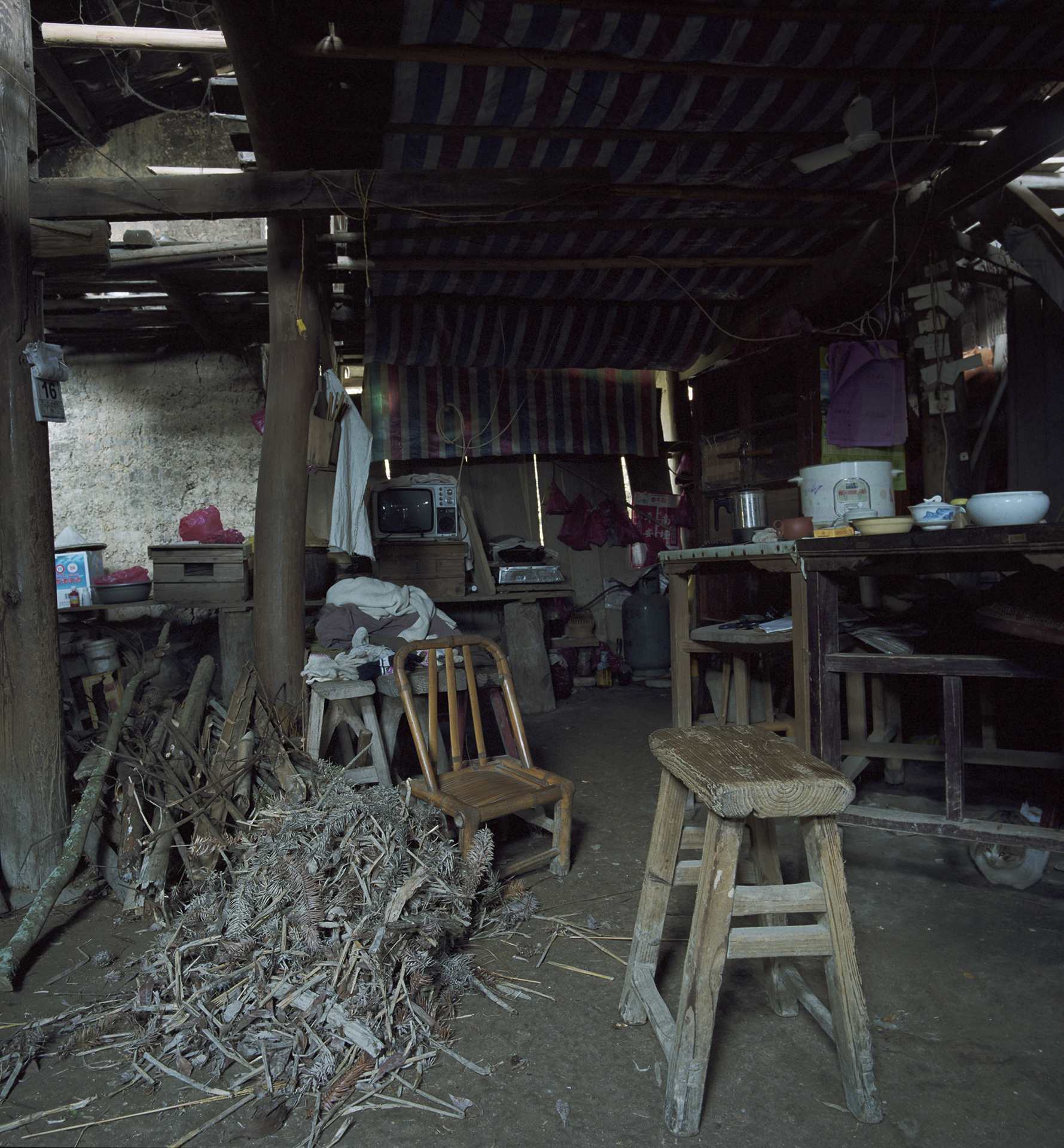 2009 Fujian - enough firewood to heat the stove in this very airy home.