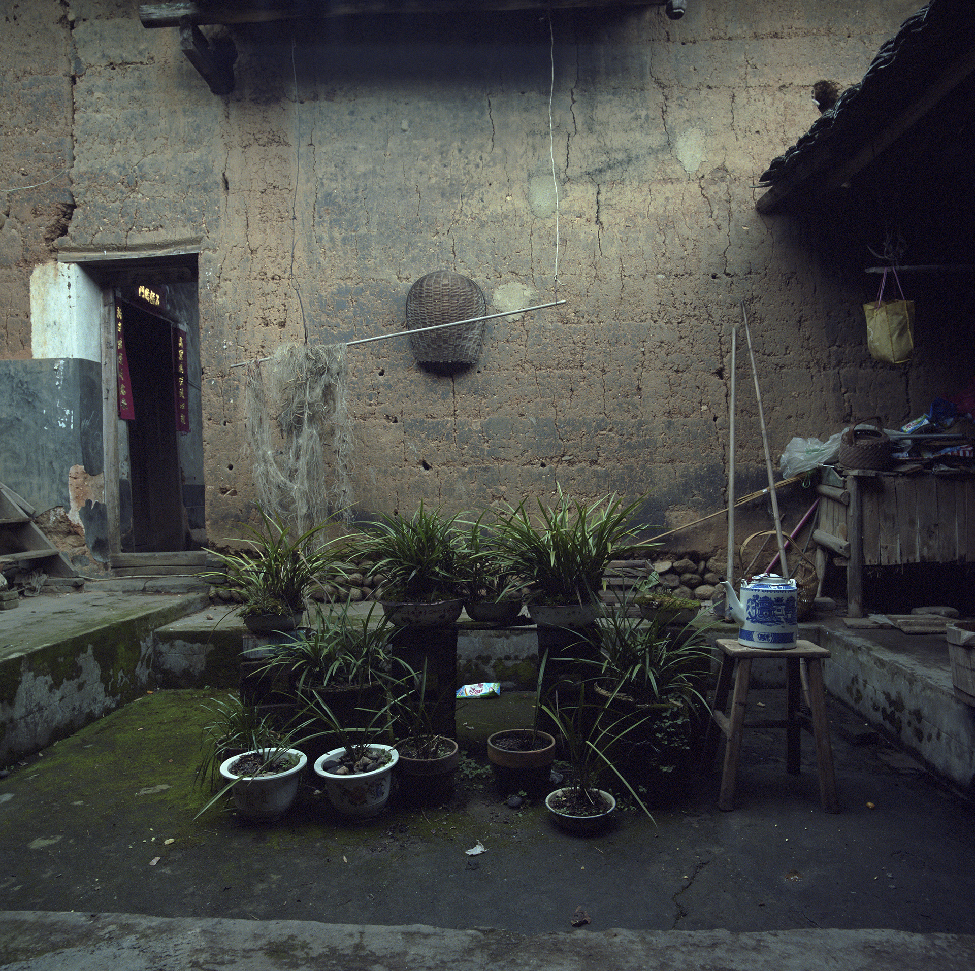 2009 Fujian - nice inner court.The basin has long been the only water source. Now there is a running tap in the village.