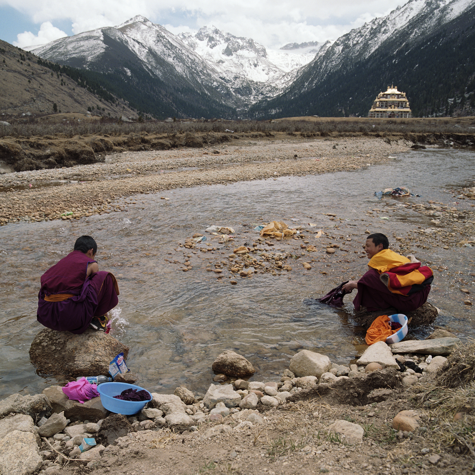 2010, near Maniggango - monks washing their cloth in very cold water.