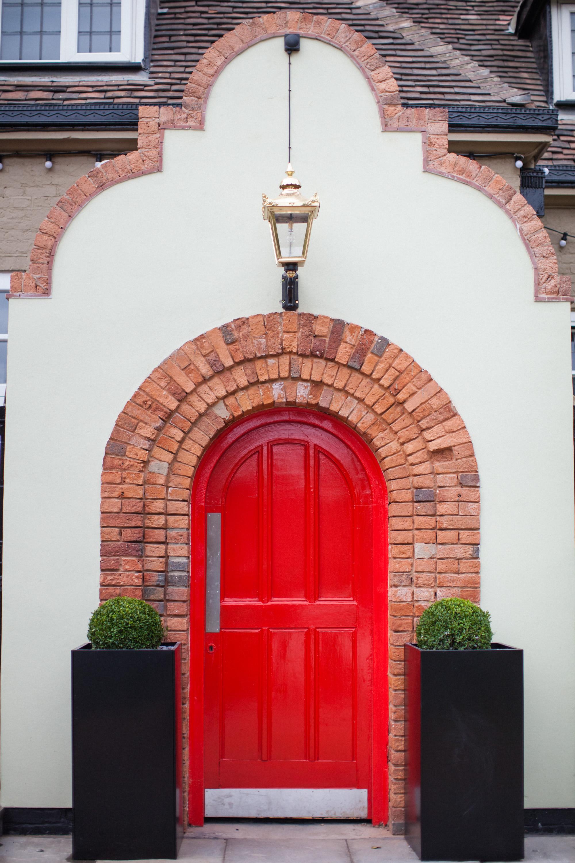 BH_EXT_RED_DOOR_FRONTON_PORTRAIT.jpg