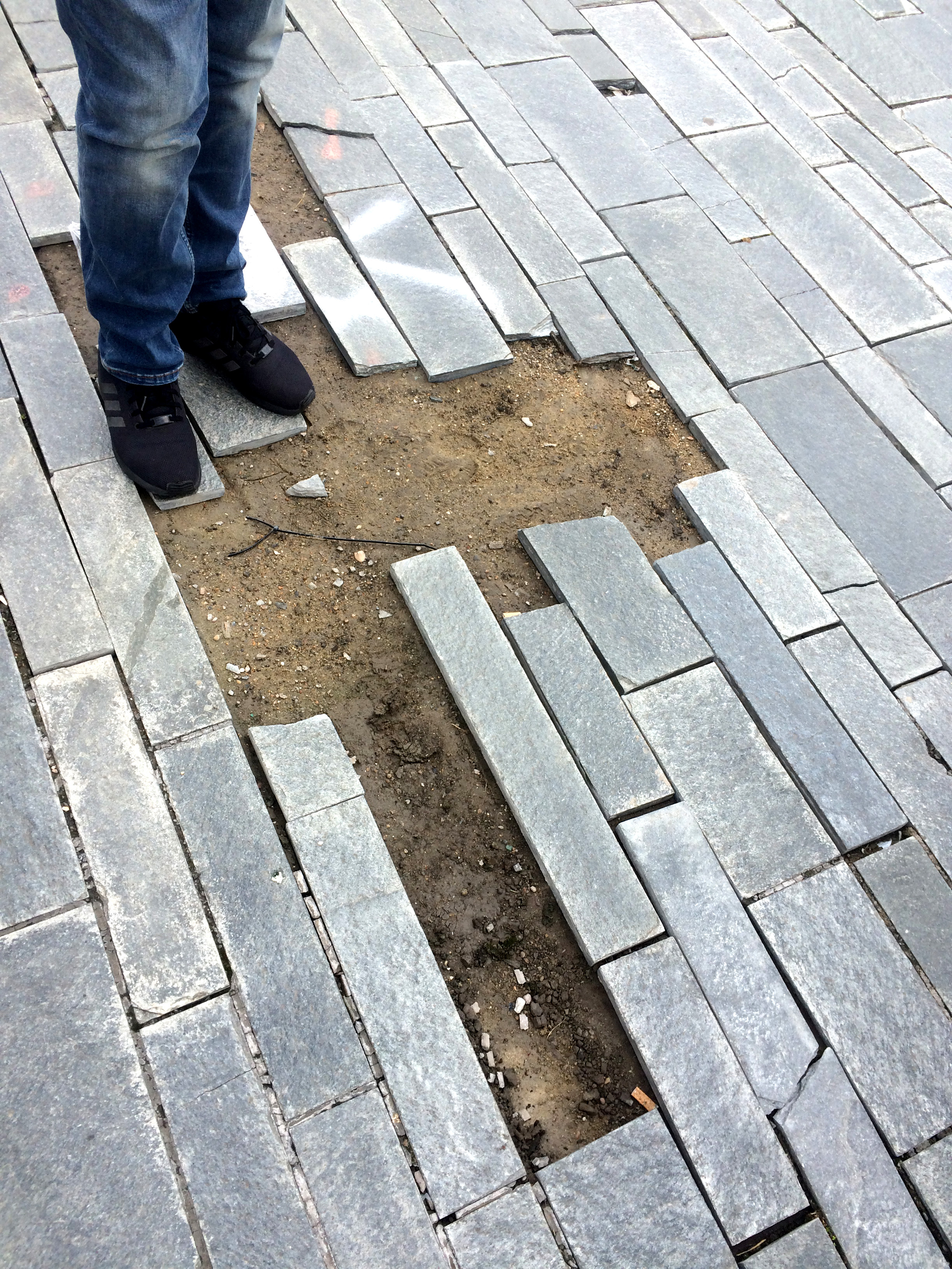 The students spot the less-than-perfect paving!